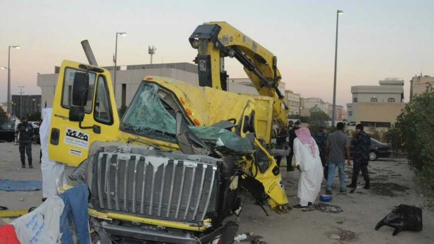 In this Saturday Oct. 8, 2016 photo released by Kuwait Ministry of Interiors, a damaged garbage truck after it rammed into another truck carrying five U.S. soldiers in Kuwait. An Egyptian driving a garbage truck loaded with explosives and Islamic State papers rammed into a truck carrying five U.S. soldiers in Kuwait on Saturday, injuring only himself in the attack, authorities said. (Kuwait Ministry of Interiors via AP)