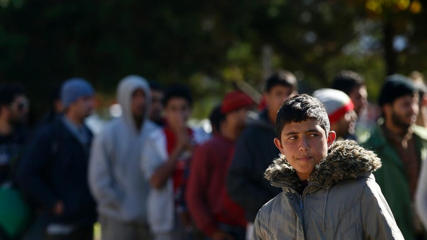 Migrants queue for food in a park where hundreds of migrants are temporarily residing in Belgrade, Serbia, Thursday, Oct. 6, 2016. Thousands of young Afghan men remain in Serbia looking for ways to reach wealthy EU nations, despite closed borders and reports that their government in Kabul has agreed to cooperate on the return of its citizens that have been rejected for asylum. (AP Photo/Darko Vojinovic)