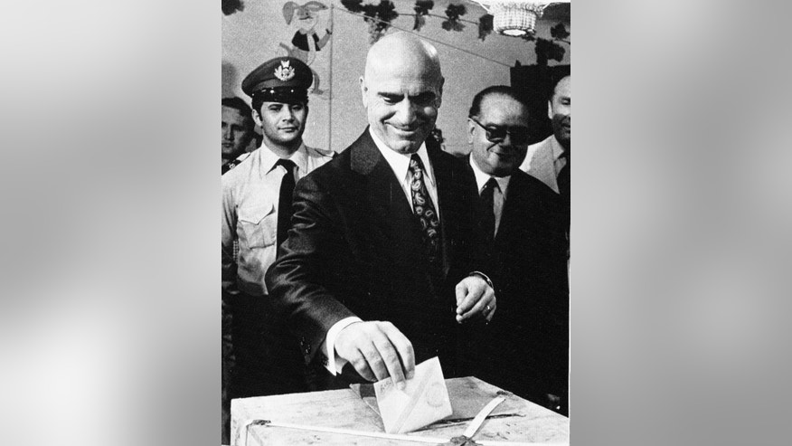 FILE - In this July 29, 1973 file photo, Deputy Premier Stylianos Pattakos casts his ballot in a referendum in Athens. Pattakos, the last survivor among the leaders of a 1967 coup that ruled Greece for seven years, has died at 103. The state-run Athens News Agency reported that he died following a stroke on Saturday. (AP Photo/Aristotle Saris, File)