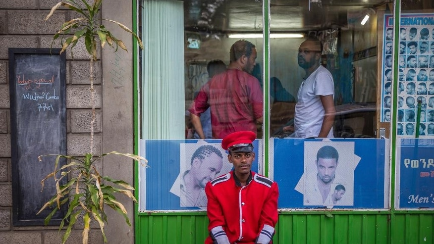 A security guard sits near a gate in Addis Ababa, Ethiopia Monday, Oct. 10, 2016. Ethiopia's government on Monday blamed Egypt for supporting outlawed rebels and forcing the declaration of the country's first state of emergency in a quarter-century as widespread anti-government protests continue, though Egypt last week denied any support for the Ethiopian rebels. (AP Photo/Mulugeta Ayene)