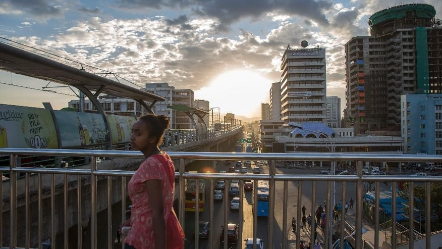 A woman walks on bridge to a station of the city's light railway, in Addis Ababa, Ethiopia Monday, Oct. 10, 2016. Ethiopia's government on Monday blamed Egypt for supporting outlawed rebels and forcing the declaration of the country's first state of emergency in a quarter-century as widespread anti-government protests continue, though Egypt last week denied any support for the Ethiopian rebels. (AP Photo/Mulugeta Ayene)
