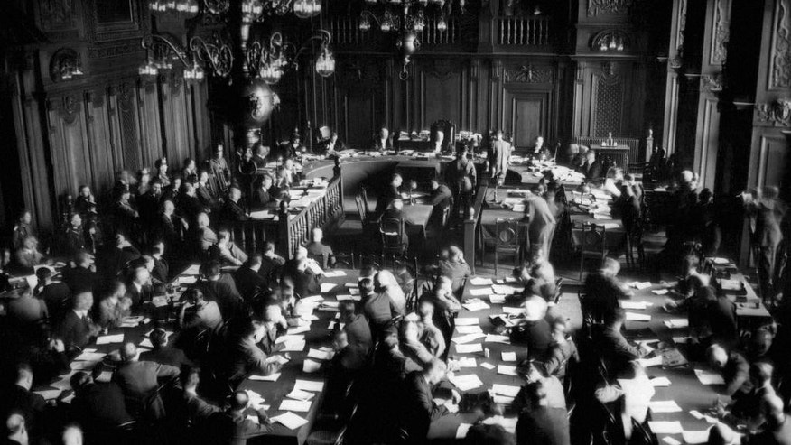 FILE - The Sept. 29, 1933 file photo shows a general view of a courtroom in the hall of justice at Leipzig, Germany, where Marinus Van Der Lubbe and four communists have been tried for burning the Reichstag building. A new study published Monday, Oct. 10, 2016 details how thousands of Germans who committed crimes during the Third Reich were protected by former Nazi party members holding key positions in the post-war legal system. (AP Photo)