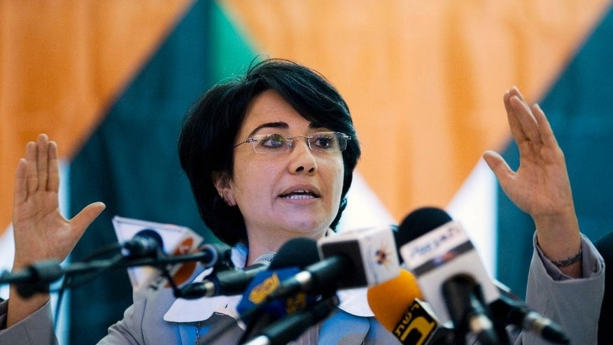 FILE -- In this June 1, 2010 file photo, Israeli Arab lawmaker Hanin Zoabi speaks to the press in Nazareth, northern Israel. Israeli police said Monday, Oct. 10, 2016 that they are investigating two Arab lawmakers on suspicion of money laundering and fraud. The police say Zoabi and Jamal Zahalka of the Balad party are suspected in crimes related to the smuggling of hundreds of thousands of dollars into Israel from Jordan. Balad is a Palestinian nationalist party whose members frequently clash with the Israeli government. (AP Photo/Ariel Schalit, File)