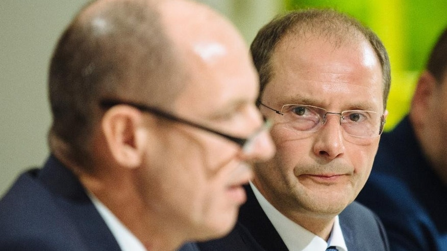 Saxony criminal police chief Joerg Michaelis and Saxony's Interior Minister Markus Ulbig, from left, attend a news conference in Dresden, eastern Germany, Monday, Oct. 10, 2016, after the 22-years-old Jaber Albakr was arrested in the eastern city of Leipzig, following a nearly two-day manhunt after explosives have been found in his apartment on Saturday. (Oliver Killig/dpa via AP)