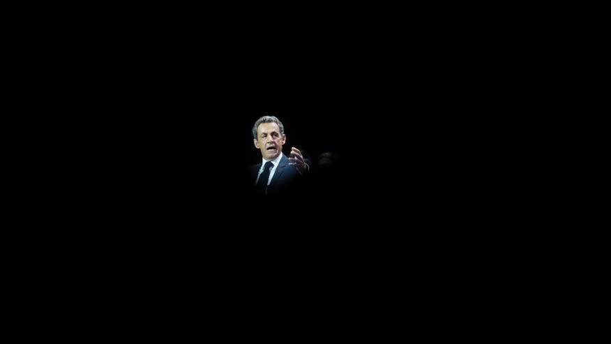 Former French President Nicolas Sarkozy delivers his speech as he runs for the 2017 presidential election in Paris, France, Sunday, Oct. 9, 2016. (AP Photo/Christophe Ena)