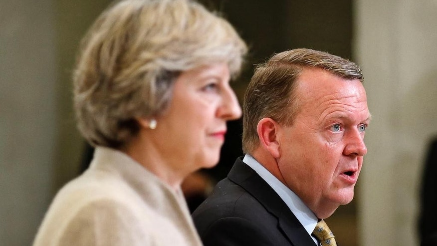 Denmark's Prime Minister Lars Loekke Rasmussen and British Prime Minister Theresa May, during a press conference after their meeting, at the Prime Minister's Resident Marienborg, north of Copenhagen, Denmark, Monday, Oct. 10, 2016. (Jens Dresling/Polfoto via AP)