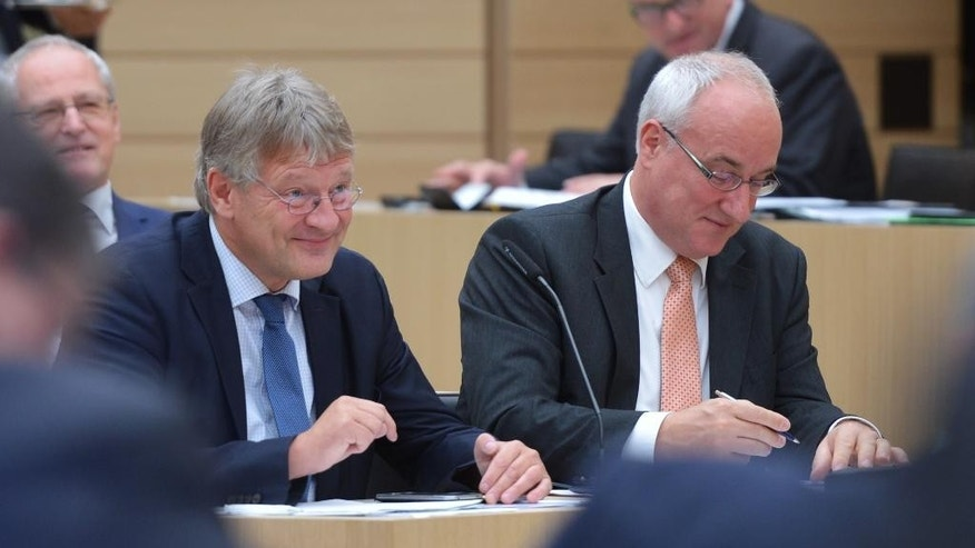 FILE - In this Sept. 28, 2016 file photo the AfD chairman Joerg Meuthen, left, and Heiner Merz attend a session of the state parliament in German state of Baden-Wuerttemberg. The German nationalist party has ended a dispute that split its parliamentary  group in a state legislature and exposed divisions in its national leadership. (Silas Stein/dpa via AP)