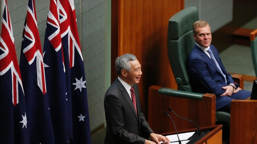 Singapore's Prime Minister Lee Hsien Loong, left, addresses the Australian Parliament in Canberra, Wednesday, Oct. 12, 2016. (AP Photo/Sean Davey)