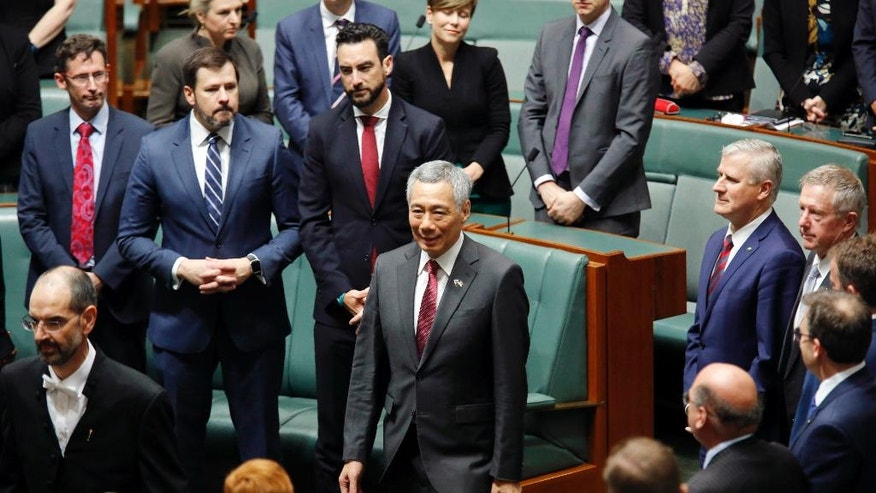 Singapore's Prime Minister Lee Hsien Loong, center, enters the Australian Parliament in Canberra before his address Wednesday, Oct. 12, 2016. (AP Photo/Sean Davey)