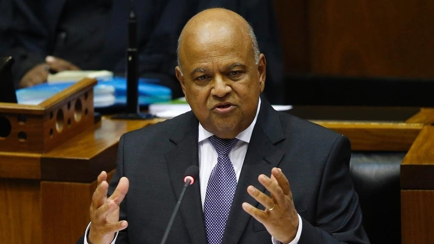 FILE -- In this Feb. 24, 2016, file photo, South African Finance Minister Pravin Gordhan delivers the annual budget speech in parliament in Cape Town, South Africa. South African prosecutors say Gordhan faces a fraud charge and must appear in court on Nov. 2, deepening uncertainty about the country's weak economy and the leadership of President Jacob Zuma. (AP Photo/Mike Hutchings, Pool, File)
