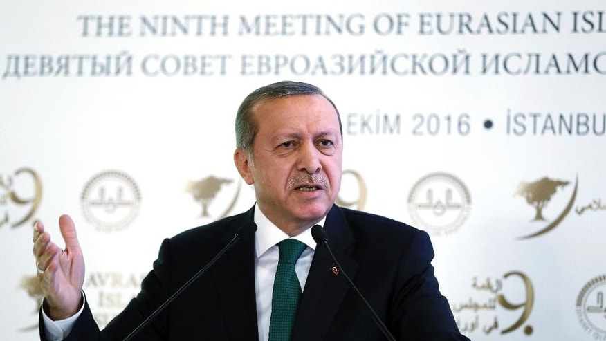 Turkish President Recep Tayyip Erdogan speaks during a meeting on Islam in Eurasia in Istanbul, Tuesday, Oct. 11, 2016. Erdogan says his country is determined to take part in a possible operation to recapture the Iraqi city of Mosul despite objections from Iraq, adding to tensions between the two neighbors. Erdogan on Tuesday also said Turkish troops would not withdraw from a base in northern Iraq near Mosul, where they are training anti-IS fighters Iraqi, saying the Turkish army would not take orders from Baghdad.(Kayhan Ozer, Presidential Press Service, Pool photo via AP)