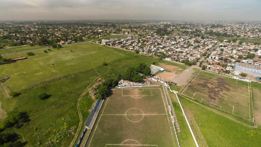 An aerial view of Club Social y Deportivo Liniers' soccer field in San Justo on the outskirts of Buenos Aires, Argentina, Wednesday, Oct. 12, 2016. The fifth-division club in Argentina has been playing nearly 30 years in a crooked field. The Argentine Football Association gave the club a Dec. 15 deadline to fix the field or risk its permanent closure after realizing the field has one half  shorter than the other and from above it looks more like a trapezoid than a rectangle. (AP Photo/Leo La Valle)