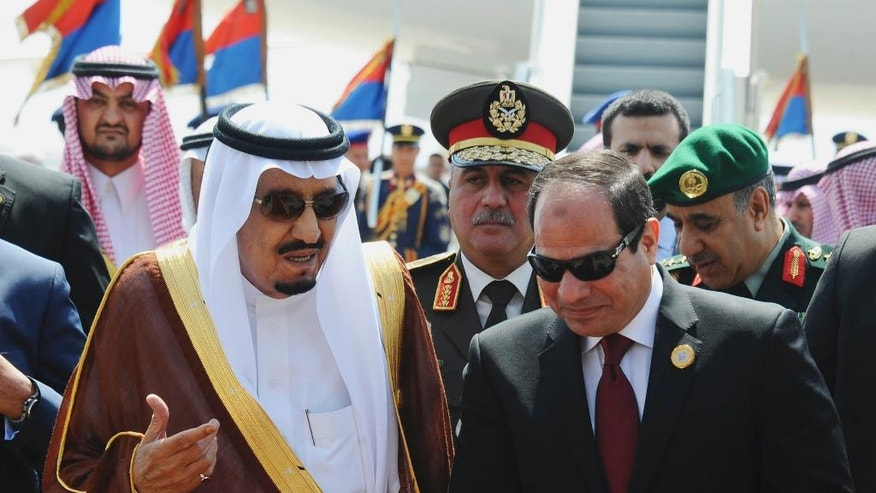 FILE -- In this March 28, 2015 file photo provided by Egypt's state news agency MENA, Egyptian President Abdel-Fattah el-Sissi, right, talks with Saudi King Salman after the king arrived in Sharm el-Sheikh, Egypt. Close allies Egypt and Saudi Arabia are having their first public spat since Egyptian President Abdel-Fattah el-Sissi took office two years ago. The disagreement is over Syria, where Riyadh says Syrian President Bashar Assad must be removed for that country's civil war to end, while Cairo advocates a political process that denies Islamic militants any role in Syria's future. Egypt voted in favor of separate Russian and French draft resolutions on Syria at the U.N. Security Council on Saturday, Oct. 8, 2016. (MENA via AP, File)