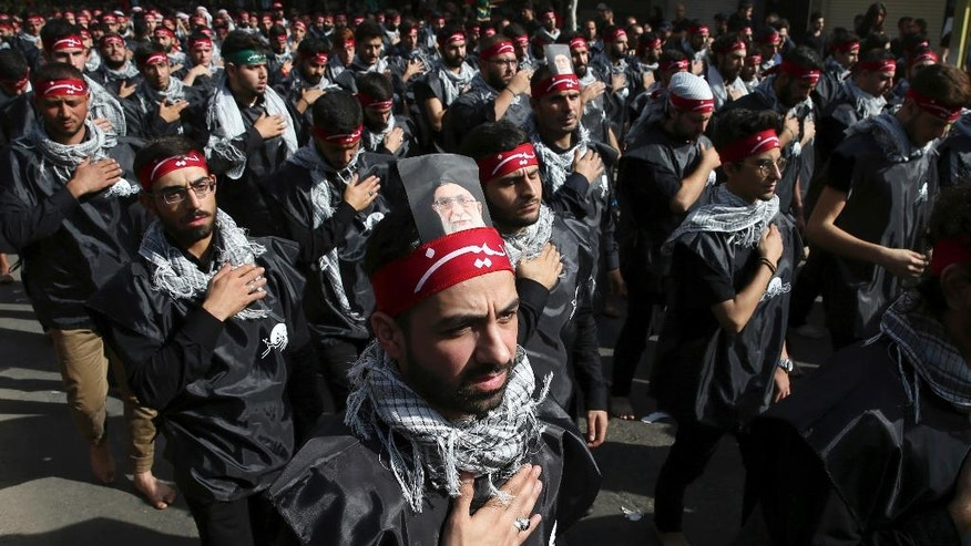 Lebanese Shiite supporters of the Iranian-backed Hezbollah group, beat their chests as they march during the holy day of Ashoura, in a southern suburb of Beirut, Lebanon, Wednesday, Oct. 12, 2016. Lebanese Shiites mark Ashoura, the tenth day of the Islamic month of Muharram, to commemorate the Battle of Karbala in the 7th century when Imam Hussein, a grandson of Prophet Muhammad, was killed in present-day Iraq. (AP Photo/Hussein Malla)