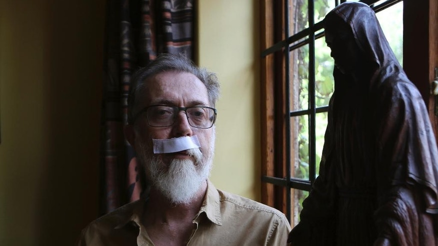 Father Graham Pugin poses for a photograph as he recovers at a residence in Johannesburg, Wednesday, Oct. 12, 2016. Pugin was hit in the face on Monday by a police rubber bullet at the gates of the Holy Trinity Catholic Church during fighting between South African police and protesting university students this week. (AP Photo/Denis Farrell)