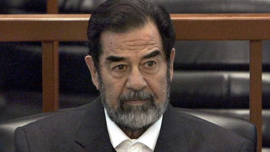 "In this Dec. 6, 2006 file photo, former Iraq leader Saddam Hussein sits in court in Baghdad, Iraq, during the ""Anfal"" trial against him"