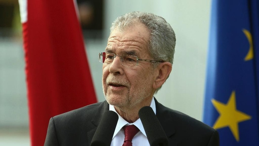 FILE - In this May 23, 2016 file photo Alexander Van der Bellen, who believed to have won theAustria's presidential election, speaks to press in Vienna, Austria. Members of Austria's elite Cobra police commando unit have been assigned to protect the left-leaning candidate for Austria's presidency in response to death threats from right-wing extremists.   (AP Photo/Ronald Zak, file)