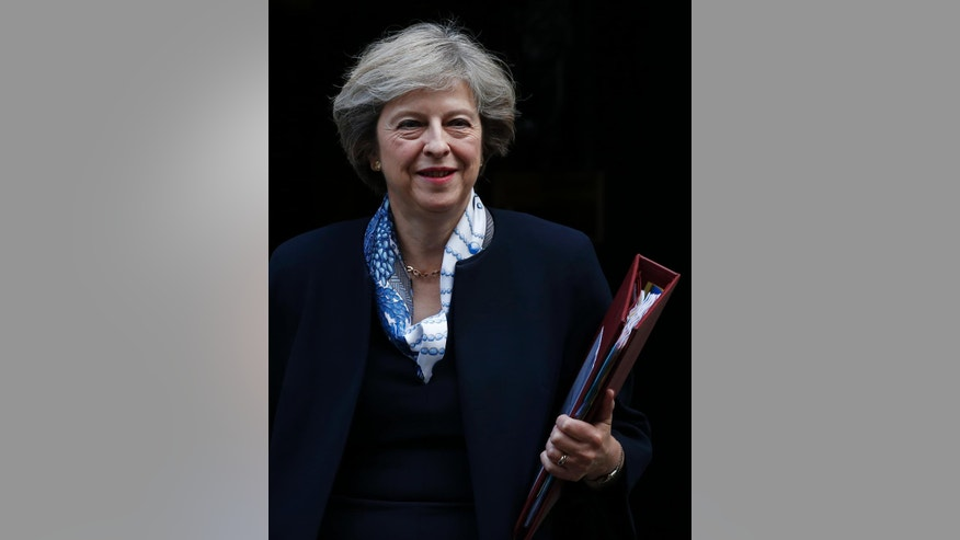 Britain's Prime Minister Theresa May leaves 10 Downing Street for the House of Commons for her weekly Prime Minister's Questions, in London, Wednesday, Oct. 12, 2016. (AP Photo/Alastair Grant)