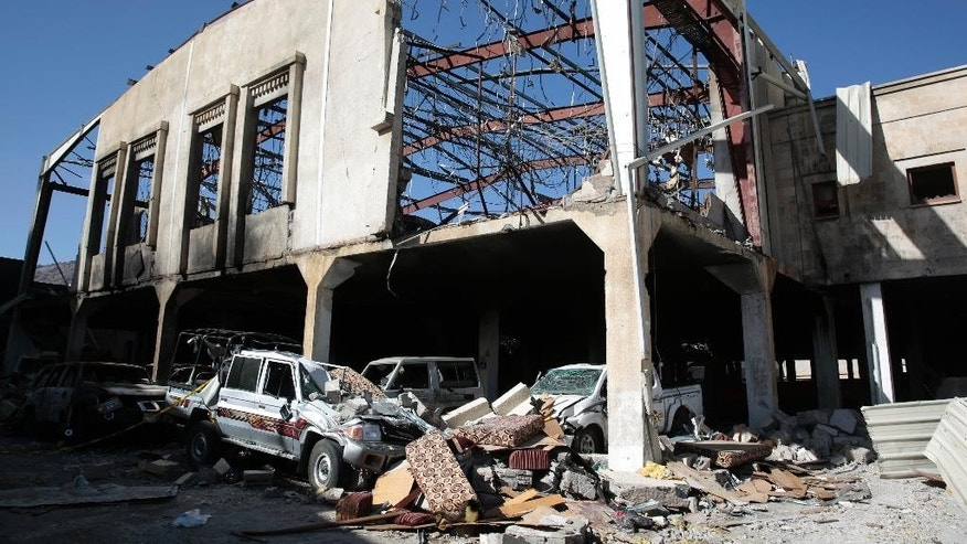 "Damaged vehicles remain outside a funeral hall that was hit by a Saudi-led airstrike on Saturday, in Sanaa, Yemen, Monday, Oct. 10, 2016. Zeid Ra'ad al-Hussein, the U.N. human rights chief on Monday denounced the suspected Saudi-led airstrike on the hall that was packed with thousands of mourners that killed at least 140 people, and faulted the Human Rights Council for not doing more in the face of a ""climate of impunity"" in the impoverished, war-torn country. (AP Photo/Hani Mohammed)"