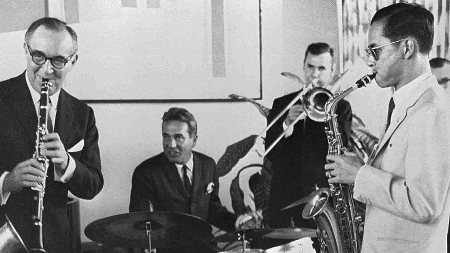FILE - In this July 5, 1960, file photo, Thailand's King Bhumibol Adulyadej, right, plays the saxophone during a jam session with legendary jazz clarinetist Benny Goodman, left, drummer Gene Krupa, second left, and trombonist Urbie Green in New York. Thailand's Royal Palace said on Thursday, Oct. 13, 2016, that Thailand's King Bhumibol Adulyadej, the world's longest-reigning monarch, has died at age 88. (Bureau of the Royal Household via AP, File)