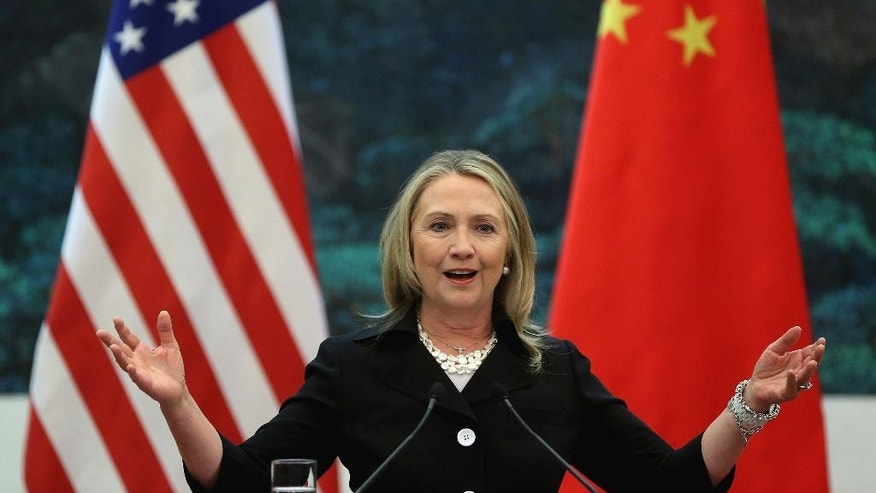 "FILE - In this Sept. 5, 2012 file photo, then U.S. Secretary of State Hillary Clinton speaks during her joint conference with Chinese Foreign Minister Yang Jiechi at the Great Hall of the People in Beijing when talks between Clinton and Chinese leaders failed to narrow gaps on how to end the crisis in Syria and how to resolve Beijing's territorial disputes with its smaller neighbors over the South China Sea. Clinton privately said the U.S. would ""ring China with missile defense"" if the Chinese government failed to curb North Korea's nuclear program, a potential hint at how the former secretary of state would act if elected president. Clinton's remarks were revealed by WikiLeaks in a hack of the Clinton campaign chairman's personal account. (Feng Li/Pool Photo via AP, File)"