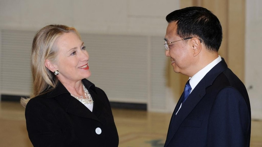 "FILE - In this Sept. 5, 2012 file photo, then U.S. Secretary of State Hillary Clinton, left, shakes hands with then Chinese Vice Premier Li Keqiang during their meeting at the Great Hall of the People in Beijing. Clinton privately said the U.S. would ""ring China with missile defense"" if the Chinese government failed to curb North Korea's nuclear program, a potential hint at how the former secretary of state would act if elected president. Clinton's remarks were revealed by WikiLeaks in a hack of the Clinton campaign chairman's personal account. (Minoru Iwasaki/Pool Photo via AP, File)"