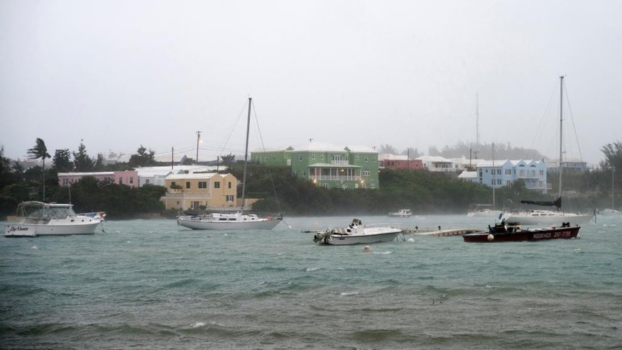 Heavy rain and increasing winds rock boats moored in Mullet Bay in St. Georges, Bermuda, Thursday, Oct. 13, 2016 as the island begins to feel the effects of Hurricane Nicole. The hurricane had strengthened to a Category 4 storm late Wednesday but lost some steam overnight. However, forecasters warned that it was still extremely dangerous. (AP Photo/Mark Tatem)