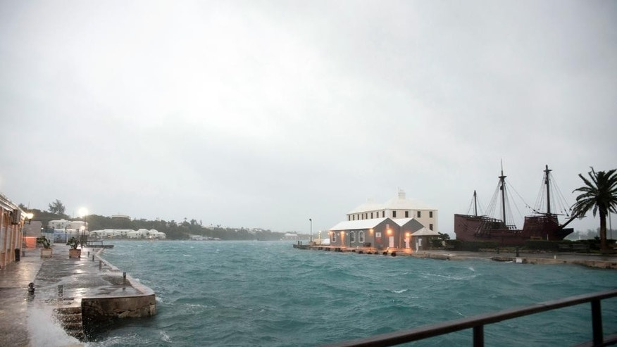 Wind brought by Hurricane Nicole makes water break over the dock on Ordnance Island in St. Georges, Bermuda, Thursday, Oct. 13, 2016. The hurricane had strengthened to a Category 4 storm late Wednesday but lost some steam overnight. However, forecasters warned that it was still extremely dangerous. (AP Photo/Mark Tatem)