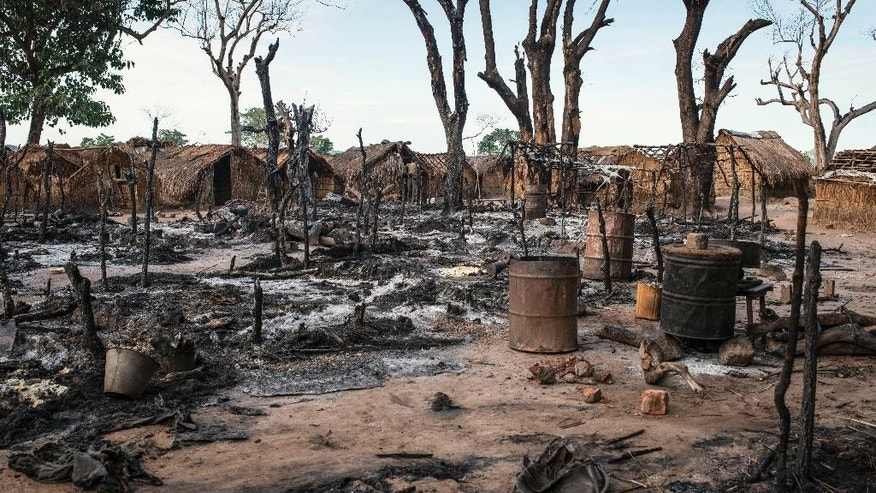 In this photo provided by International Rescue Committee, burnt huts are seen in the Kaga Bandoro refugee camp in Central African Republic, Thursday, Oct. 13, 2016. Fighters with the former Seleka rebel group attacked a northern town in Central African Republic overnight Wednesday, and clashes left at least 30 dead and 57 wounded as United Nations peacekeepers confronted them, the U.N. said. The attack in Kaga-Bandoro was likely retaliation for the death on Tuesday of a suspected former Seleka member, the peacekeeping mission said in a statement. Peacekeepers repelled the attackers, killing at least 12 of them, the U.N. mission said. (David Belluz/International Rescue Committee via AP)