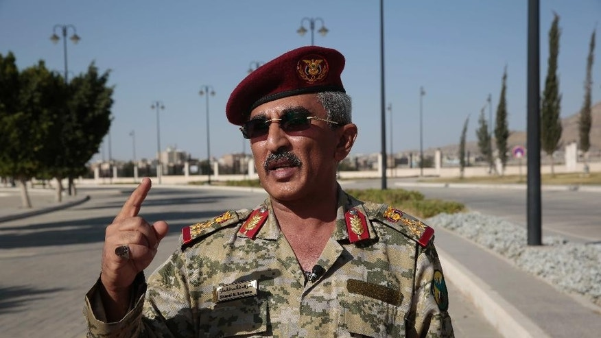 Yemen's army spokesman Brigadier General Sharaf G. Loqman, left, speaks to a reporter during an interview with The Associated Press in Sanaa, Yemen, Thursday, Oct. 13, 2016. U.S.-launched Tomahawk cruise missiles destroyed three coastal radar sites in Houthi-controlled territory on Yemen's Red Sea Coast early Thursday, officials said, a retaliatory action that followed two incidents this week in which missiles were fired at U.S. Navy ships. Loqman said that the army never targets ships outside the territorial waters and only those that enter the Yemeni waters come under attack. (AP Photo/Hani Mohammed)