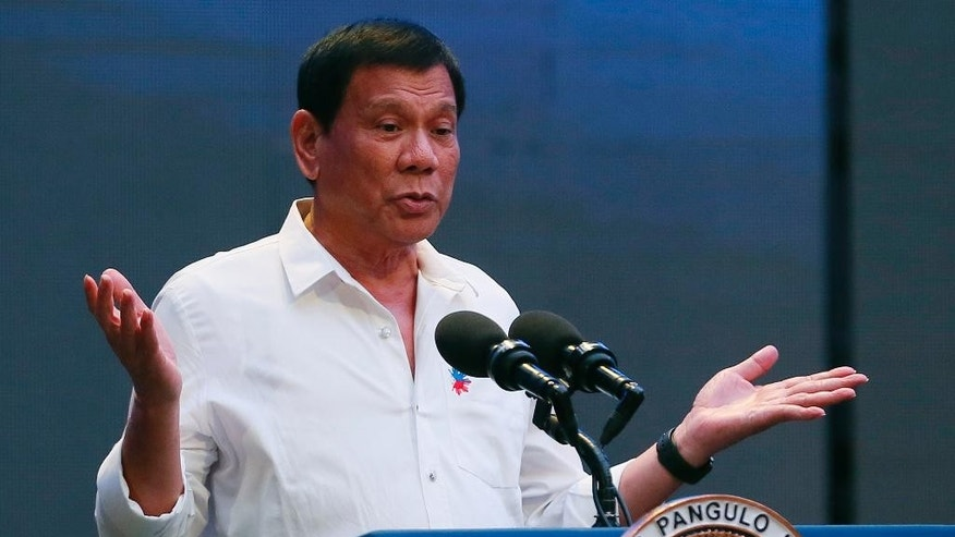 "Philippine President Rodrigo Duterte gestures during his address to a Filipino business sector in suburban Pasay city south of Manila, Philippines Thursday, Oct. 13, 2016. Duterte has been under criticism by international human rights groups, the United Nations, European Union and the United States for the more than 3,000 deaths of mostly suspected drug-users and drug-pushers in his so-called ""War on Drugs"" campaign since assuming the presidency on June 30. (AP Photo/Bullit Marquez)"