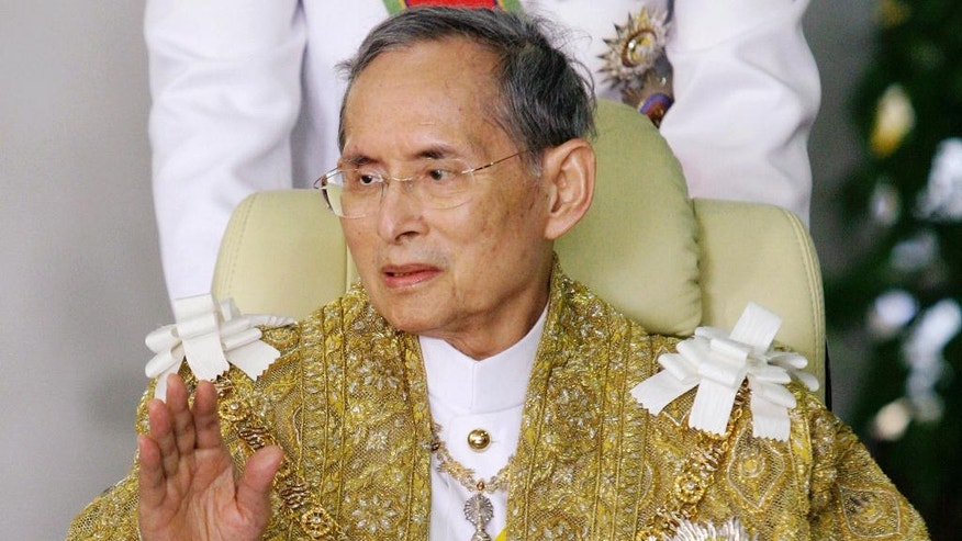 FILE - In this Dec. 5, 2010, file photo, Thailand's King Bhumibol Adulyadej waves to well-wishers as he returns to Siriraj Hospital after attending a ceremony to celebrate his birthday in Bangkok.  Thailand's Royal Palace said on Thursday, Oct. 13, 2016, that Thailand's King Bhumibol, the world's longest-reigning monarch, has died at age 88. (AP Photo, File)