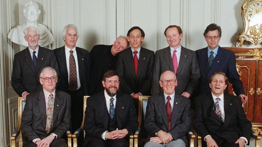 FILE - This Dec. 9, 1997 file photo shows that year's Nobel laureates, including Italy's Dario Fo, literature, back row third from left, posing together at The Swedish Academy in Stockholm, for the traditional picture.  According to ANSA news agency Fo died on Thursday, Oct. 13, 2016 in Milan at the age of 90.  From left in back row; Jens C. Skou, chemistry winner from Denmark, Stanley B. Prusiner medicine, U.S., Italian Dario Fo literature, Steven Chu, U.S., physics and Robert C. Merton and Myron S.Scholes, both Americans and laureates in economics. In front row chemistry prize winner from England, John E Walker, William D. Phillips,U.S., physics and countryman Paul D. Boyer winner in chemistry, and Claude Cohen-Tannoudji laureate in chemistry from France. (AP Photo/Jonas Ekstromer, file)