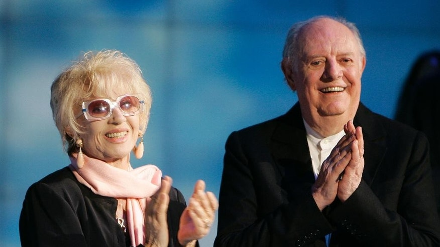 "FILE - In this May 9, 2009 file photo Italian Nobel prize winner Dario Fo, right, and his wife Franca Rame applaud during the Italian State RAI TV program ""Che Tempo che Fa"", in Milan, Italy.  According to ANSA news agency Fo died on Thursday, Oct. 13, 2016 in Milan at the age of 90. (AP Photo/Antonio Calanni, File)"
