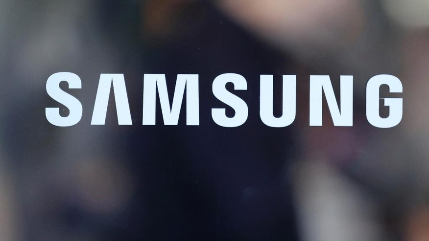 In this Tuesday, Oct. 11, 2016 photo, the corporate logo of Samsung Electronics Co. is seen in Seoul, South Korea. Samsung Electronics said Thursday, Oct. 13, 2016, it has expanded its recall of Galaxy Note 7 smartphones in the U.S. to include all replacement devices the company offered as a presumed safe alternative after the original Note 7s were found prone to catch fire. (AP Photo/Lee Jin-man)