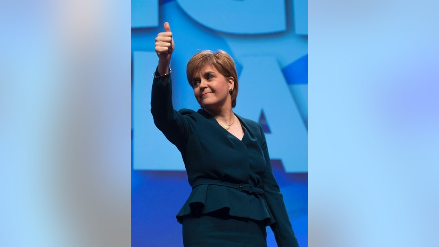 First Minister of Scotland and the leader of the Scottish National Party Nicola Sturgeon gestures, at the start of the SNP's biggest-ever conference, in Glasgow, Scotland, Thursday, Oct. 13, 2016. Scotland's leader says she will publish a bill next week laying the groundwork for a new independence referendum — the first step toward a new vote on whether Scotland should leave the United Kingdom. (John Linton/PA via AP)
