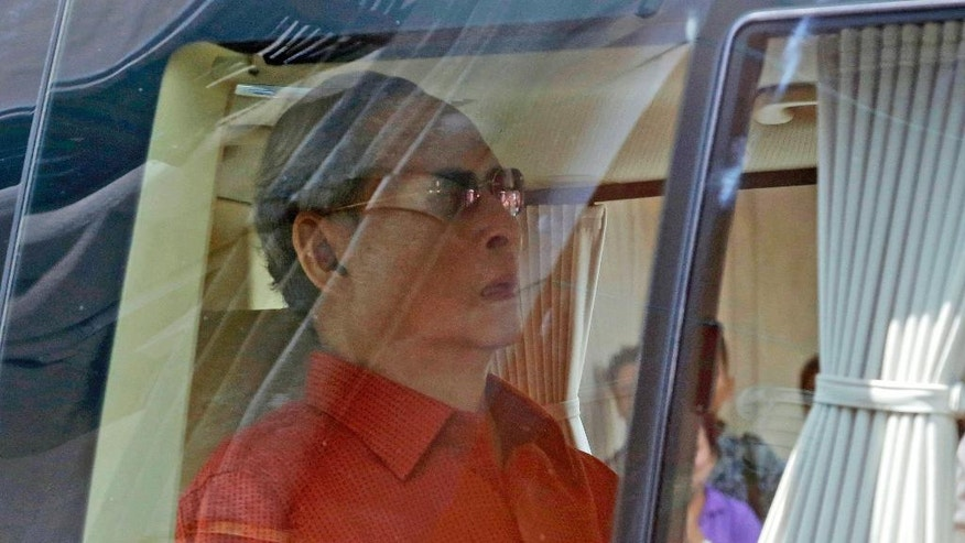 FILE - In this May 10, 2015, file photo, Thailand's King Bhumibol Adulyadej is seated in in a car as leaves Siriraj Hospital in Bangkok to return to his seaside palace. Thailand's Royal Palace said on Thursday, Oct. 13, 2016, that Thailand's King Bhumibol, the world's longest-reigning monarch, has died at age 88. (AP Photo/Sakchai Lalit, File)