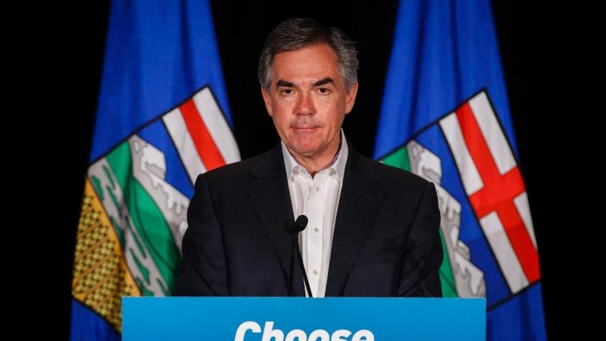 FILE - In this May 5, 2015 file photo, Alberta PC Party leader Jim Prentice speaks to party faithful in Calgary, Alberta, Canada.  Prentice and three others died in the crash of a small plane in southern British Columbia. A senior government official confirmed Prentice died in the crash late Thursday, Oct. 13, 2016. The official spoke on condition of anonymity ahead of a statement to be released by the family.  (Jeff McIntosh/The Canadian Press via AP)