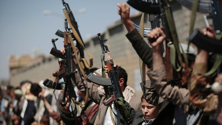 FILE -- In this Sunday, Oct. 2, 2016 file photo, tribesmen loyal to Houthi rebels hold their weapons as they chant slogans during a gathering aimed at mobilizing more fighters into battlefronts in several Yemeni cities, in Sanaa, Yemen. Yemen's civil war is threatening to further entangle the United States in it as American forces have fired missiles into the country in retaliation for attacks launched from Shiite rebel territory. The retaliatory strike comes as America has tried to back away from a Saudi-led military campaign in the country over civilian casualties caused by its airstrikes. (AP Photo/Hani Mohammed, File)