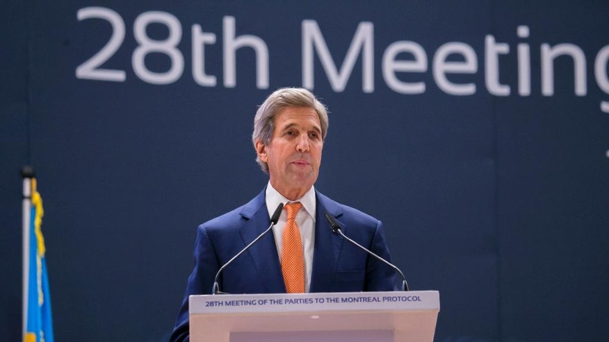 Secretary of State John Kerry delivers a speech to the 28th Meeting of the Parties to the Montreal Protocol on Substances that Deplete the Ozone Layer, in Kigali, Rwanda, Friday, Oct. 14, 2016.  The group of nations gathered in Kigali, are striving Friday for a deal to phase out hydrofluorocarbons from air conditioners and refrigerators as part of efforts to fight climate change. (AP Photo)