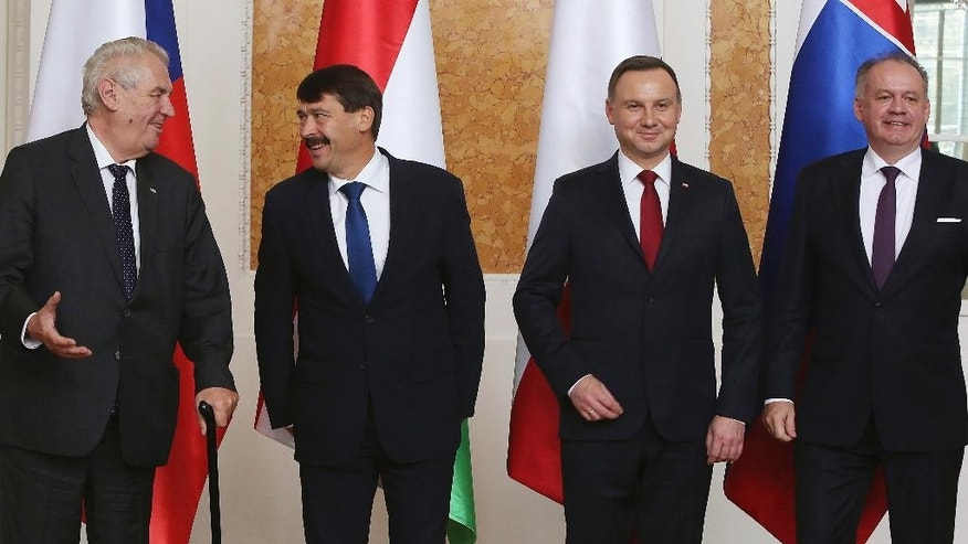 Czech Republic's president Milos Zeman, left, Hungary's president  Janos Ader, second left,  Poland's president Andrzej Duda and Slovakia's Andrej Kiska, right, [ose for the media at  the meeting of presidents of the Visegrad countries, in Lancut, Poland, Friday, Oct. 14, 2016. (AP Photo/Czarek Sokolowski)