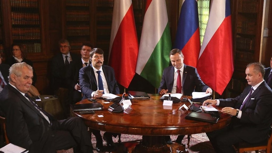 Czech Republic's president Milos Zeman, left, Hungary's Janos Ader, second left, Poland's Andrzej Duda, second right, and Slovakia's Andrej Kiska, right, attend the opening session of the meeting of presidents of the Visegrad countries, in Lancut, Poland, Friday, Oct. 14, 2016. (AP Photo/Czarek Sokolowski)