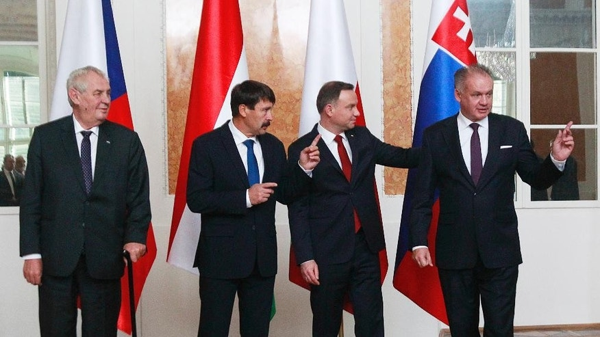 Czech Republic's president Milos Zeman, left, Hungary's  president Janos Ader, second left, Poland's  president Andrzej Duda and Slovakia's  president Andrej Kiska, right, attend the photo op of the meeting of presidents of the Visegrad countries, in Lancut, Poland, Friday, Oct. 14, 2016. (AP Photo/Czarek Sokolowski)