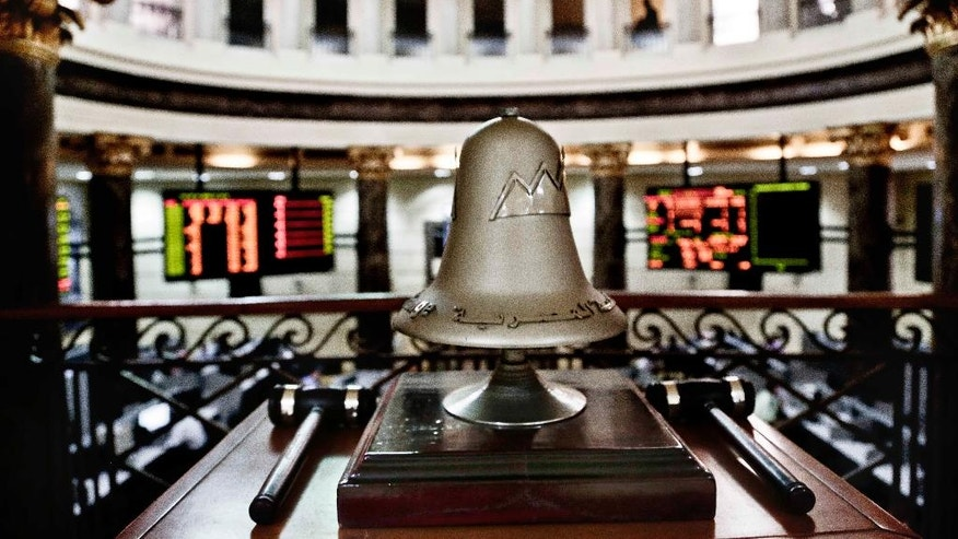 The opening bell rests above the floor of the stock market in Cairo, Egypt, Thursday, Oct. 13, 2016. Egypt is inching toward meeting conditions for a bailout package from the International Monetary Fund, as hard currency and some products become increasingly scarce while an escalating spat with key backer Saudi Arabia overshadows. (AP Photo/Nariman El-Mofty)