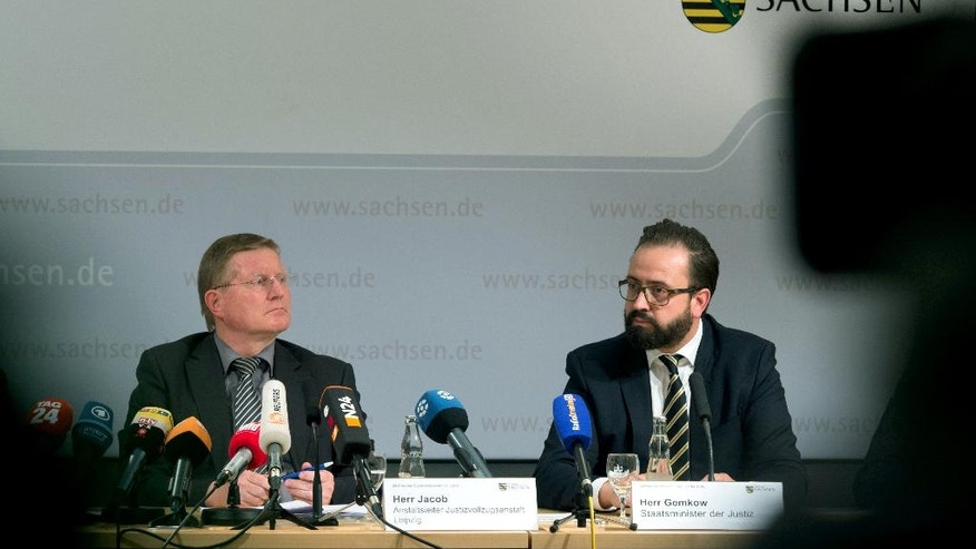 Rolf Jacob, director of the prison in Leipzig, left, and Saxony's state justice minister Sebastian Gemkow attend a press conference in Dresden, eastern Germany, Thursday, Oct. 13, 2016 after the death of 22-year-old Syrian man Jaber Albakr suspected of planning an Islamic extremist bombing attack strangled himself by tying his shirt to the bars of his jail cell. (Arno Burgi/dpa via AP)
