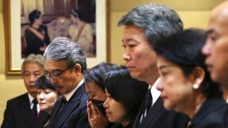 People wait to sign a book of condolences for late Thai King Bhumibol Adulyadej at the Thailand Embassy in Tokyo, Friday, Oct. 14, 2016. People across Thailand wept in grief Thursday after the palace announced the death of their beloved King Bhumibol, the nation's unifying figure and the world's longest-reigning monarch. He was 88. (AP Photo/Koji Sasahara)