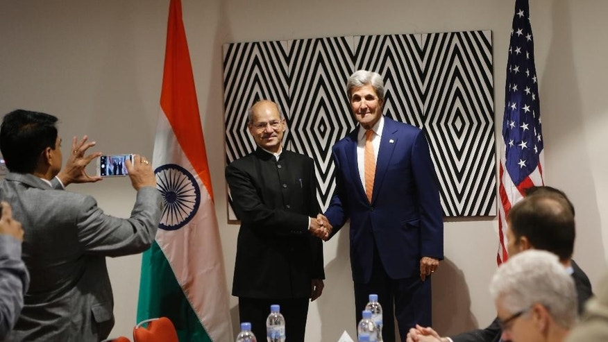 Secretary of State John Kerry, centre-right, shakes hands with India's Minister of Environment, Forest and Climate Change Shri Anil Madhav Dave, center-left, at the start of a bilateral meeting on the sidelines of the 28th Meeting of the Parties to the Montreal Protocol on Substances that Deplete the Ozone Layer, in Kigali, Rwanda Friday, Oct. 14, 2016. Many nations are meeting Friday for a deal to phase out hydrofluorocarbons from air conditioners and refrigerators as part of efforts to fight climate change. (AP Photo)