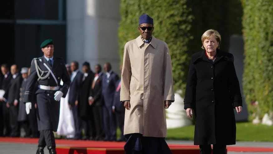 German Chancellor Angela Merkel, right, welcomes the President of Nigeria Muhammadu Buhari, left, for talks at the chancellery in Berlin, Germany, Friday, Oct. 14, 2016. (AP Photo/Markus Schreiber)