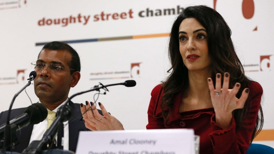 Jan. 15, 2016: Lawyer Amal Clooney sits with Mohamed Nasheed during a news conference in central London.