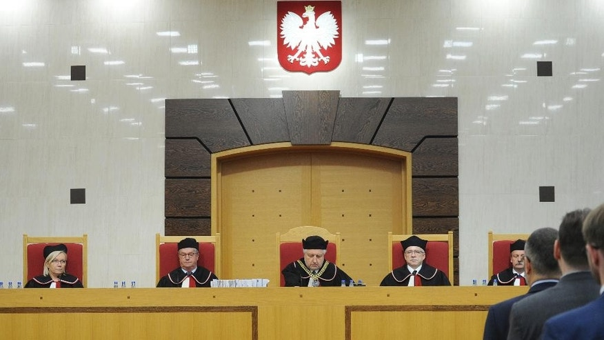 "In this Aug. 11, 2016 photo judges attend a session of the Constitutional Tribunal in Warsaw, Poland. An international human rights body, the Venice Commission, has criticized Friday Oct. 14, 2016 the new legislation in Poland regulating the Constitutional Tribunal, the nation's top legislative court, saying the new law ""gives excessive power to parliament and the executive over the judiciary."" (AP Photo/Alik Keplicz)"
